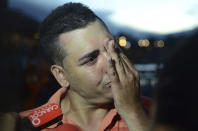 <p>Gilberto Villegas, a ferry passenger who survived after it sank in a reservoir, cries as he talks to the press in Guatape, Colombia, June, 25, 2017. Villegas said two of his relatives are still missing. (Luis Benavides/AP) </p>