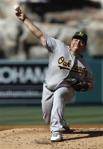 Oakland Athletics starting pitcher Bartolo Colon throws to a Los Angeles Angels batter during the second inning of a baseball game in Anaheim, Calif., Tuesday, May 15, 2012. (AP Photo/Chris Carlson)