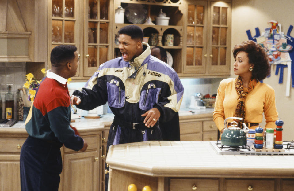"THE FRESH PRINCE OF BEL-AIR -- ""When You Hit Upon a Star"" Episode 17 -- Pictured: (l-r) Alfonso Ribeiro as Carlton Banks, Will Smith as William 'Will' Smith, Daphne Reid as Vivian Banks  (Photo by Paul Drinkwater/NBCU Photo Bank/NBCUniversal via Getty Images via Getty Images)"