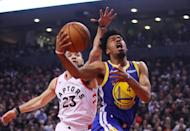 Quinn Cook #4 of the Golden State Warriors attempts a shot against Fred VanVleet #23 of the Toronto Raptors in the second quarter during Game One of the 2019 NBA Finals at Scotiabank Arena on May 30, 2019 in Toronto, Canada. (Photo by Gregory Shamus/Getty Images)