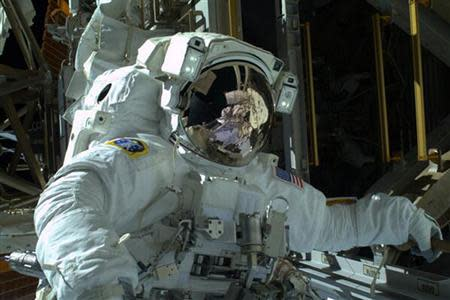 NASA astronaut Mike Hopkins is seen during the spacewalk in this photo courtesy of NASA, received December 22, 2013. REUTERS/NASA/Handout