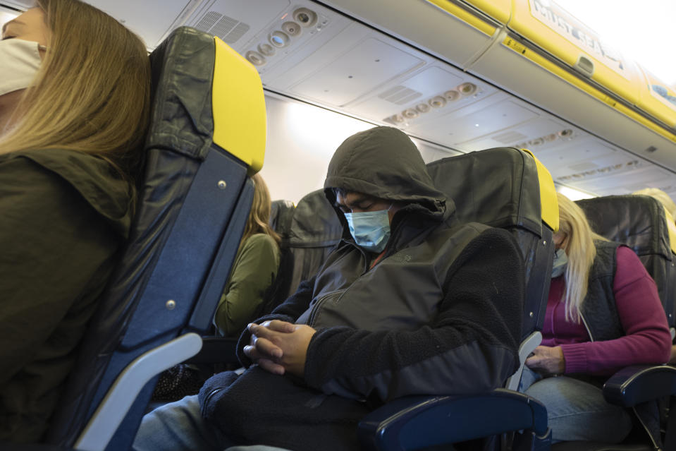 DUBLIN, IRELAND - AUGUST 04: Passengers wear face masks as they travel on a Ryan Air flight on August 04, 2020 in Dublin, Ireland. (Photo by Anthony Devlin/Getty Images)