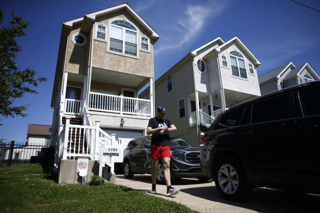 Fighter Kyle Daukaus leaves his house to exercise at Pleasant Hill Park, Saturday, May 2, 2020, in Philadelphia. Daukaus, a rising star in the regional MMA promotion Cage Fury Fighting Championships, is still chasing his dream of getting the call to fight for UFC despite the coronavirus pandemic. (AP Photo/Matt Slocum)
