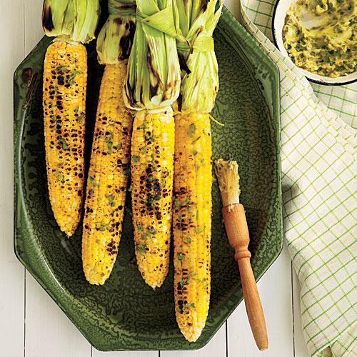 """<p>This easy, 5-ingredient grilled corn gets its flavor from jalapeño peppers that are roasted, chopped, and stirred into honey butter.</p> <p> <a rel=""""nofollow noopener"""" href=""""http://www.myrecipes.com/recipe/grilled-corn-on-cob-1"""" target=""""_blank"""" data-ylk=""""slk:View Recipe: Grilled Corn on the Cob with Roasted Jalapeño Butter"""" class=""""link rapid-noclick-resp"""">View Recipe: Grilled Corn on the Cob with Roasted Jalapeño Butter</a></p>"""