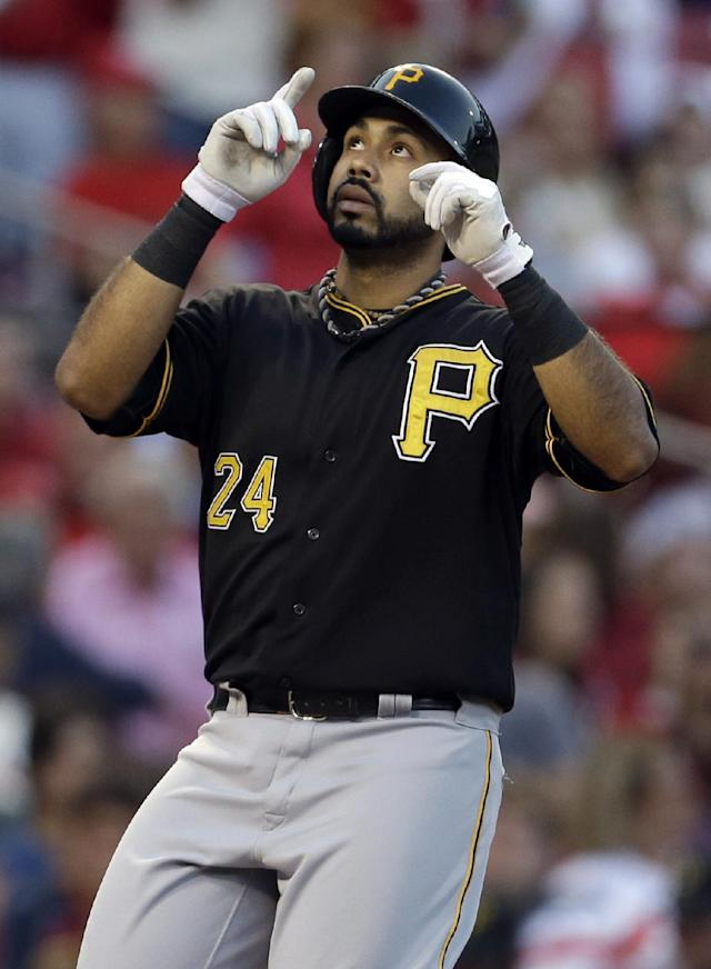 Pittsburgh Pirates' Pedro Alvarez points skyward after hitting a solo home run during the second inning of a baseball game against the St. Louis Cardinals Wednesday, Aug. 14, 2013, in St. Louis. (AP Photo/Jeff Roberson)