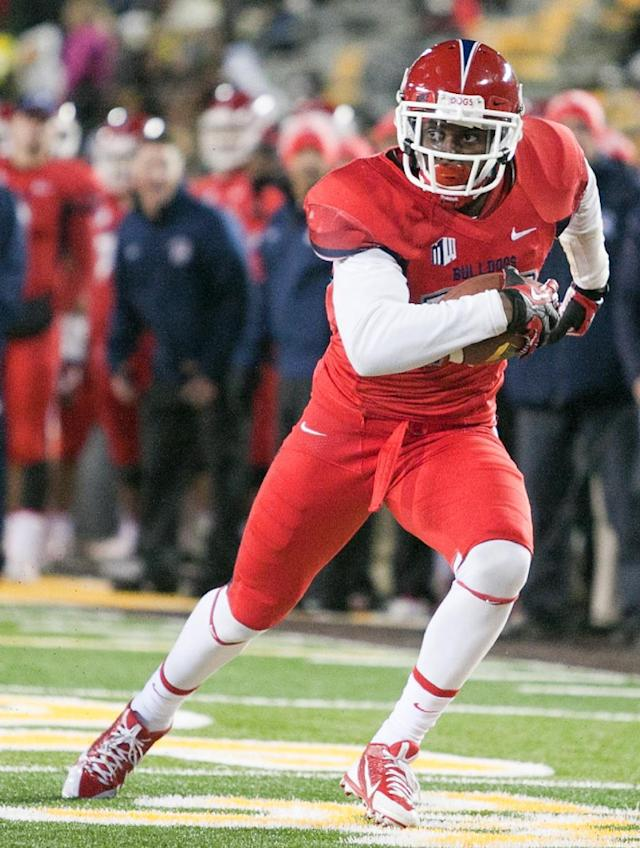 Fresno St widereceiver Davante Adams (15) turns up field after catching a pass during the first half of an NCAA college football game against Wyoming, Saturday, Nov. 9, 2013 at War Memorial Stadium in Laramie, WY. (AP Photo/Jeremy Martin)
