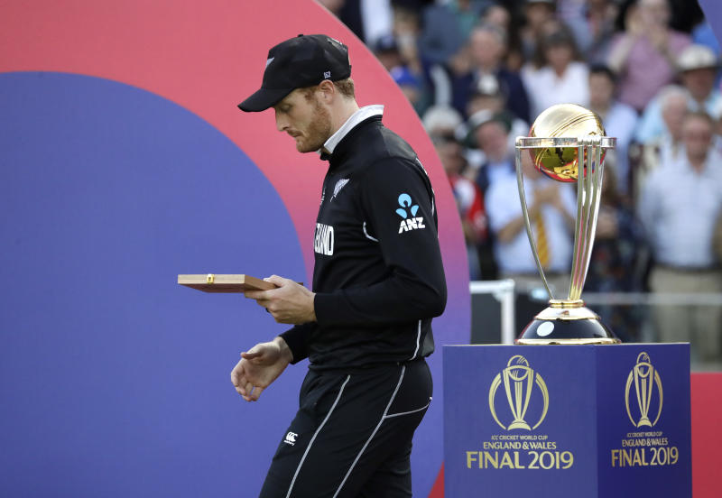 New Zealand's Martin Guptill walks away after getting his losers medal after the Cricket World Cup final match between England and New Zealand at Lord's cricket ground in London, Sunday, July 14, 2019. England won after a super over after the scores ended tied after 50 overs each. (AP Photo/Matt Dunham)