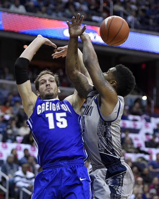 Creighton guard Ricky Kreklow (15) battles for the ball against Georgetown guard D'Vauntes Smith-Rivera, right, during the first half of an NCAA college basketball game, Saturday, Jan. 3, 2015, in Washington. (AP Photo/Nick Wass)