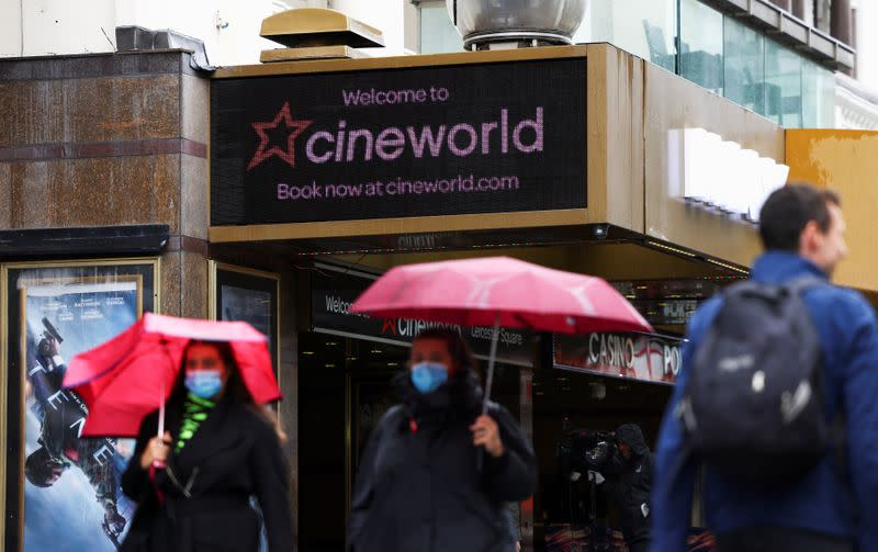 People walk past a Cineworld in Leicester's Square in London