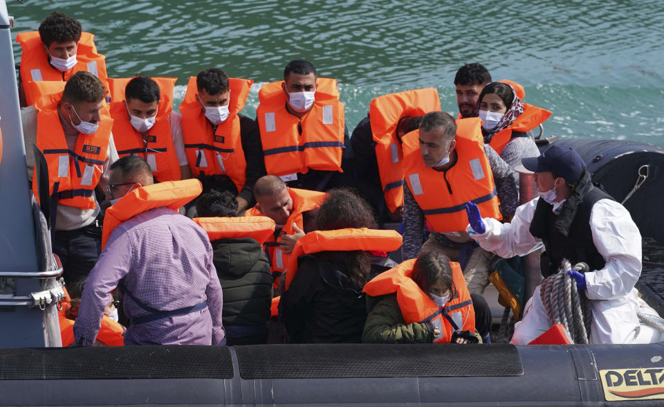 A group of people thought to be migrants are brought into port aboard a border force boat following a small boat incident in the Channel, at Dover, southern England, Wednesday July 21, 2021. The number of undocumented migrants reaching Britain in small boats this year has surpassed the total for all of 2020, as people smugglers take advantage of good weather to cross the English Channel from France. (Gareth Fuller/PA via AP)