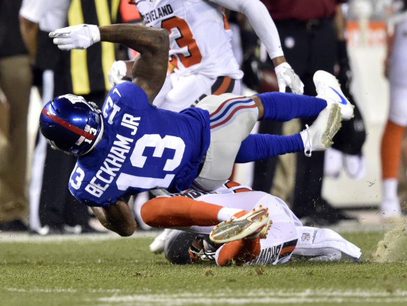 New York Giants wide receiver Odell Beckham (13) is tackled by Cleveland Browns strong safety Briean Boddy-Calhoun (20) in the first half of an NFL preseason football game, Monday, Aug. 21, 2017, in Cleveland. (AP Photo/David Richard)