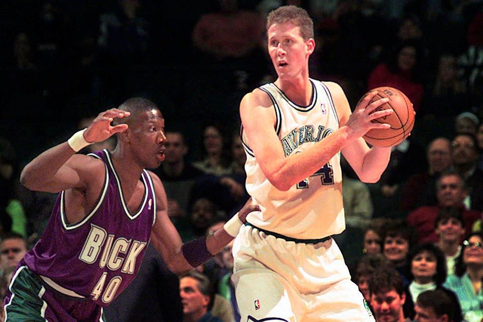 Former NBA player Shawn Bradley's bicycle collided with a passing car, which caused him to hit the rear of a parked car and flip over his handlebars, according to a police report. The accident left him paralyzed.