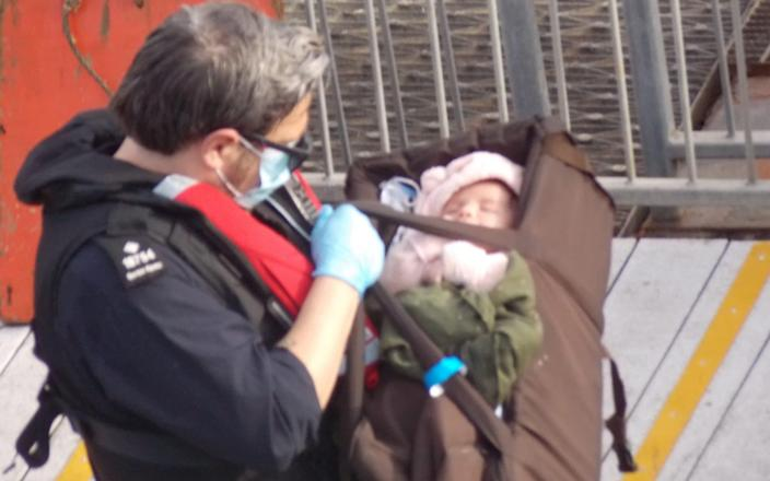 A tiny baby was among those who arrived in Dover yesterday after crossing the channel on a dinghy - Steve Laws/SWNS