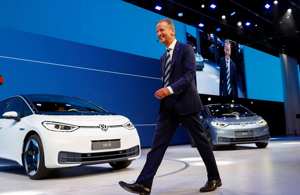 Herbert Diess, CEO of German carmaker Volkswagen AG, walks in front of ID.3 pre-production prototypes during the presentation of Volkswagen's new electric car on the eve of the International Frankfurt Motor Show IAA in Frankfurt, Germany September 9, 2019. REUTERS/Wolfgang Rattay
