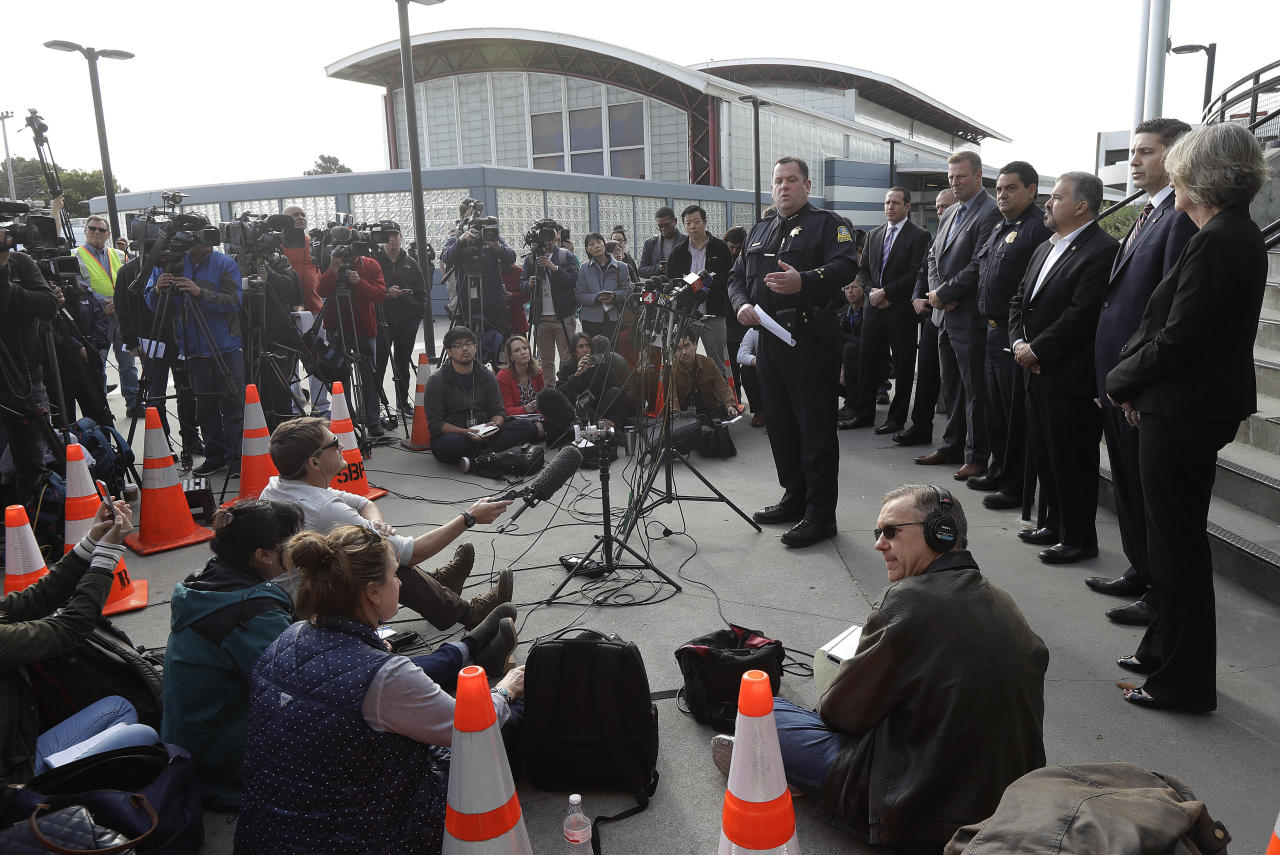 <p>San Bruno Police Chief Ed Barberini, center right, speaks at a news conference in San Bruno, Calif., Wednesday, April 4, 2018. A woman suspected of shooting three people at YouTube headquarters before killing herself was furious with the company because it had stopped paying her for videos she posted on the platform, her father said Tuesday, April 3, 2018. (Photo: Jeff Chiu/AP) </p>