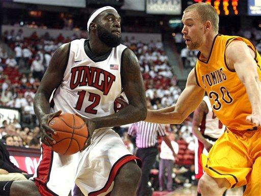 No. 17 UNLV pulls away for 74-63 win over Wyoming