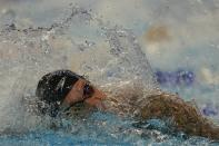 Caeleb Dressel participates in the men's 100 freestyle during wave 2 of the U.S. Olympic Swim Trials on Wednesday, June 16, 2021, in Omaha, Neb. (AP Photo/Jeff Roberson)