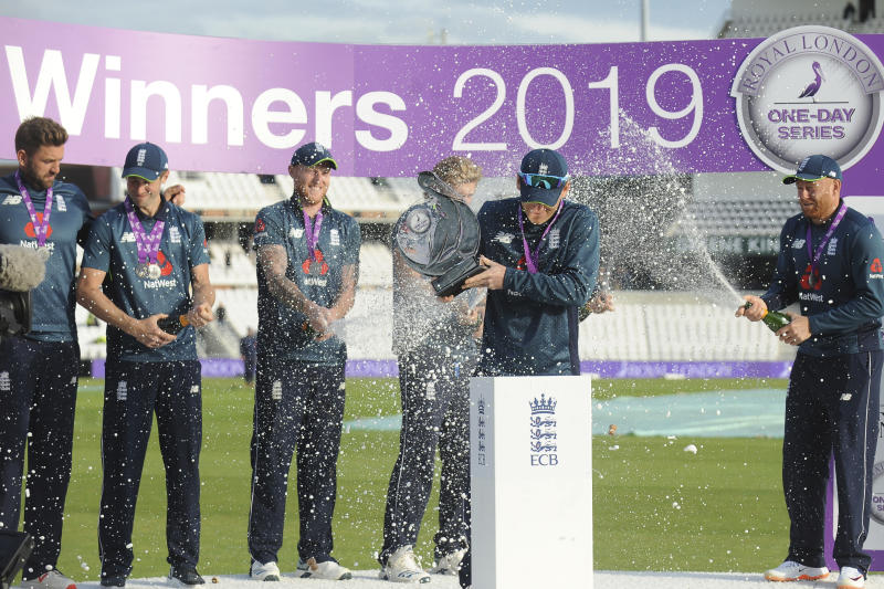 England's captain Eoin Morgan, second right, and his team players celebrate with the trophy after winning the one day international series against Pakistan at Emerald Headingley in Leeds, England, Sunday, May 19, 2019. (AP Photo/Rui Vieira)