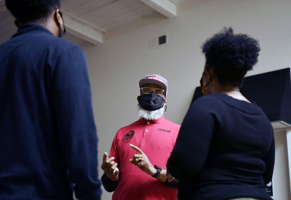 Co-owner Shawn McWilliams meets with students who participated in a pistol and safety class at 1770 Armory and Gun Club, Colorado's first Black-owned shooting range, Saturday, Oct. 24, 2020 in Denver. (Rachel Ellis/The Denver Post via AP)