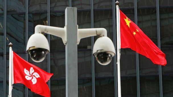 FILE PHOTO: Hong Kong and Chinese national flags are flown behind a pair of surveillance cameras outside the Central Government Offices in Hong Kong, China July 20, 2020. (Tyrone Siu/Reuters)