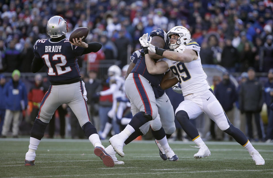 Getting to Tom Brady in the pocket has been extremely difficult in the playoffs for New England's opponents. (AP)