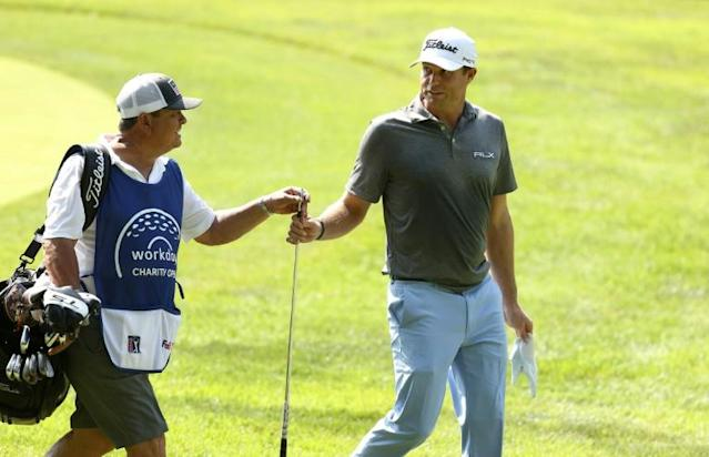 American Nick Watney hands his club to his caddie on the 15th hole while competing in the first round of the Workday Charity Open with two other players who tested positive for the coronavirus (AFP Photo/Gregory Shamus)