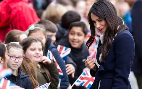 Meghan Markle chats to youngsters - Credit: Heathcliff O'Malley for The Telegraph