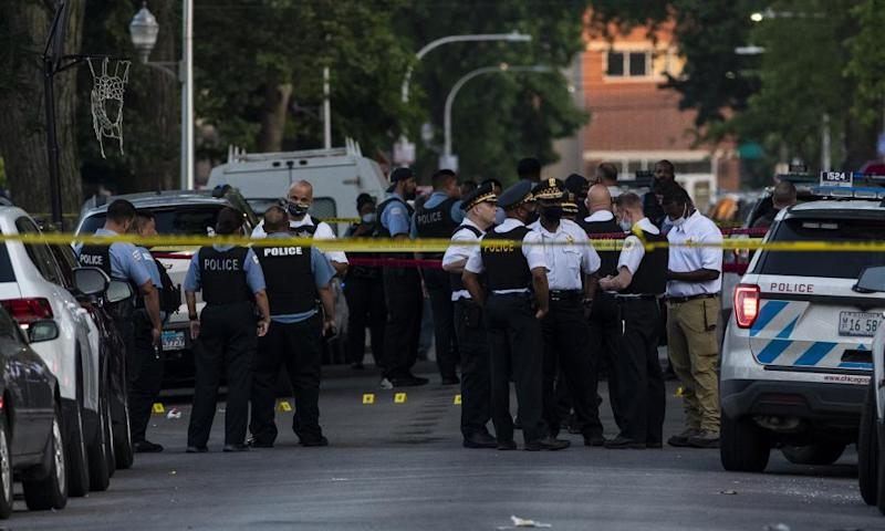 Chicago police investigate the scene where a seven-year-old girl was fatally shot in the Austin neighborhood of Chicago on Friday.