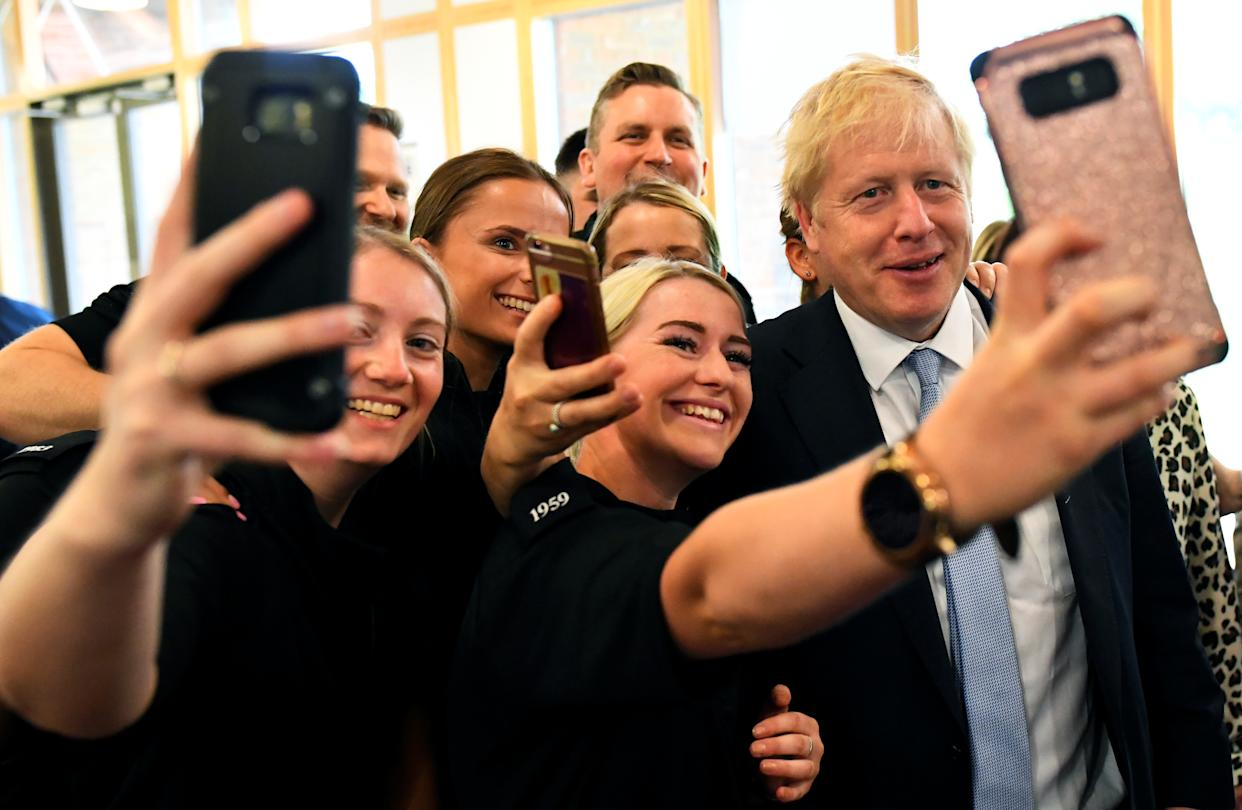 Boris Johnson, a leadership candidate for Britain's Conservative Party, poses for a picture as he visits the Thames Valley Police Training Centre in Reading, Britain, July 3, 2019. REUTERS/Dylan Martinez/Pool