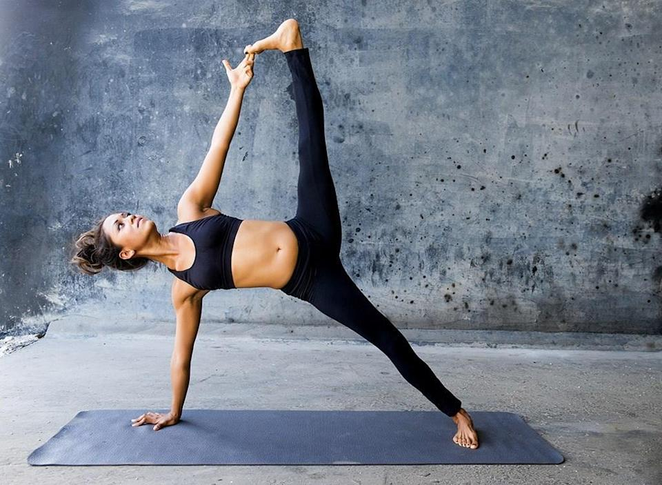 Woman doing yoga side plank