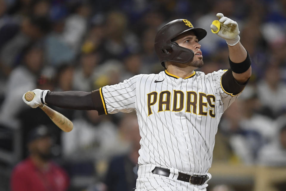 San Diego Padres' Victor Caratini (17) hits a solo home run during the seventh inning of a baseball game against the Los Angeles Dodgers Wednesday, June 23, 2021, in San Diego. (AP Photo/Denis Poroy)