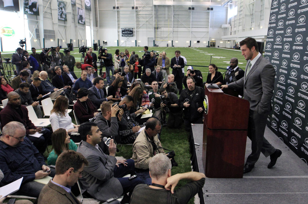 FILE - In a Monday, March 26, 2012, file photo, Tim Tebow holds his first news conference with the New York Jets, in Florham Park, after he was acquired in a trade with Denver. Likely done in New York after one frustrating season and Jacksonville already saying no to a happy homecoming, what's next for Tebow, one of the league's most popular and polarizing players? A backup role on another NFL team? A position change? The Canadian Football League? Well, even Tebow isn't sure.(AP Photo/Mel Evans, File)