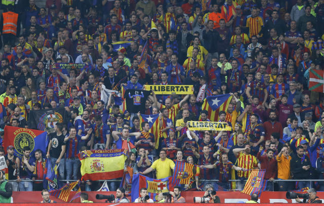 Barcelona's fans cheer during the Copa del Rey final soccer match between Barcelona and Sevilla at the Wanda Metropolitano stadium in Madrid, Spain, Saturday, April 21, 2018. (AP Photo/Francisco Seco)