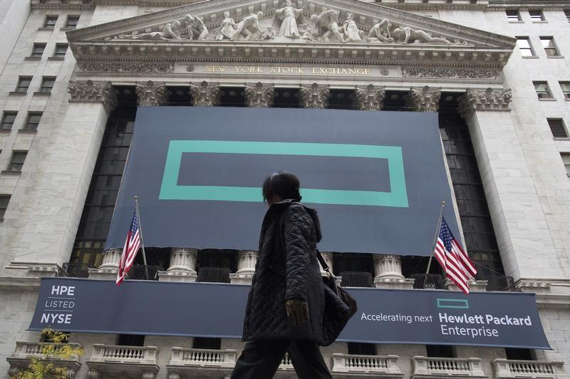 Signs for Hewlett Packard Enterprise Co., cover the facade of the New York Stock Exchange