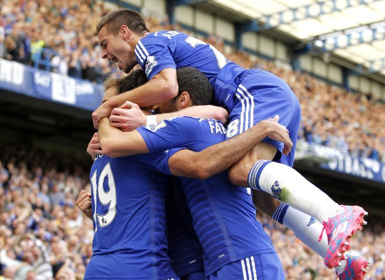 Chelsea's Diego Costa (L) celebrates with his teammates during their Premier League match against Leicester City at Stamford Bridge on August 23, 2014