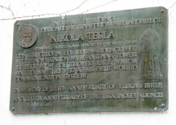 FILE -An undated file photo provided by the Tesla Science Center at Wardenclyffe, shows a plaque affixed to a Shoreham, N.Y. building that was once the laboratory of physicist/inventor Nicola Tesla. The Tesla Science Center at Wardenclyffe, which raised $1.3 million in a six-week online fundraising effort, has purchased the laboratory and property for $850,000. (AP Photo/Tesla Science Center at Wardenclyffe, File)