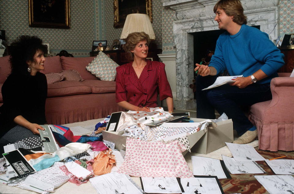 LONDON, UNITED KINGDOM - AUGUST 06:  David & Elizabeth Emanuel With Princess Diana Looking At Designs And Fabrics In Her Sitting Room At Kensington Palace. They Were Planning Her Outfits For A Forthcoming Tour Of The Gulf States  (Photo by Tim Graham Photo Library via Getty Images)