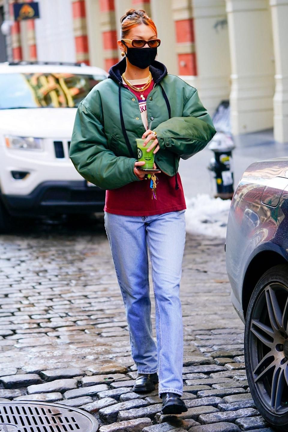 <p>Another day, another green juice for Bella Hadid, who matches her drink to her jacket in New York City on Tuesday.</p>