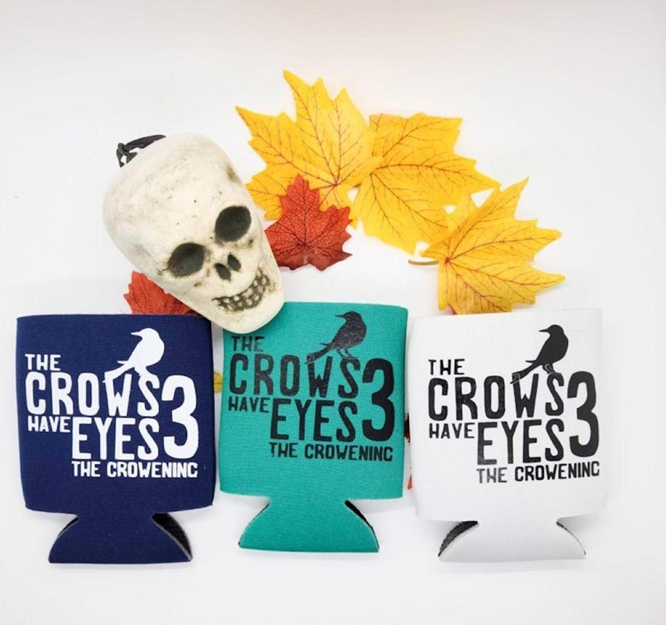 <p>The movie might not be real but they can at least feel like they have a piece of its merch with a <span>The Crows Have Eyes 3 Koozie</span> ($7).</p>