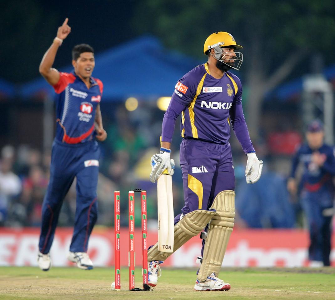 PRETORIA, SOUTH AFRCA - OCTOBER 13:  Yusuf Pathan of the Knight Riders reacts after being bowled by Umesh Yadav (L) of the Daredevils during the Karbonn Smart CLT20 match between Kolkata Knight Riders (IPL) and Delhi Daredevils (IPL) at SuperSport Park on October 13, 2012 in Pretoria, South Africa.  (Photo by Lee Warren/Gallo Images/Getty Images)