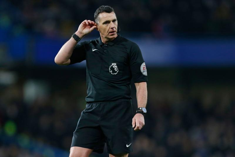 English referee Neil Swarbrick is pictured during the English Premier League football match between Chelsea and Swansea City at Stamford Bridge in London on November 29, 2017. Chelsea won the game 1-0. / AFP PHOTO / Ian KINGTON / RESTRICTED TO EDITORIAL USE. No use with unauthorized audio, video, data, fixture lists, club/league logos or 'live' services. Online in-match use limited to 75 images, no video emulation. No use in betting, games or single club/league/player publications. / (Photo credit should read IAN KINGTON/AFP via Getty Images)