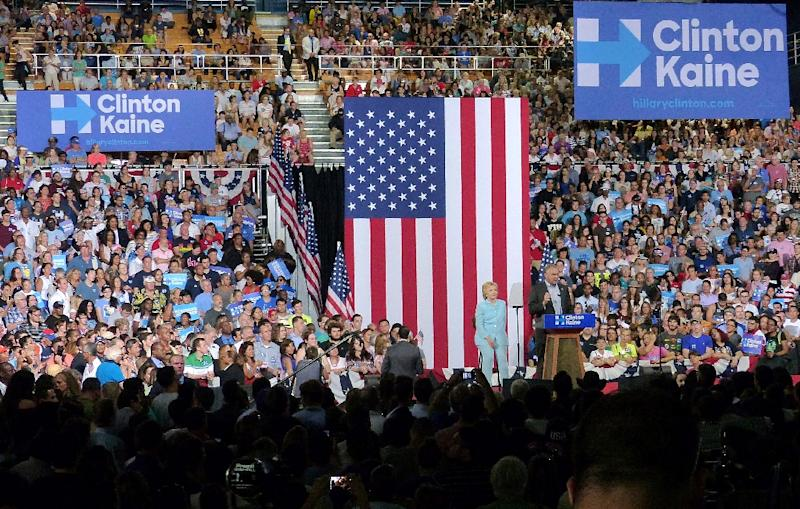 Democratic presidential candidate Hillary Clinton and her running mate Tim Kaine in Miami on July 23, 2016 (AFP Photo/Gaston De Cardenas)