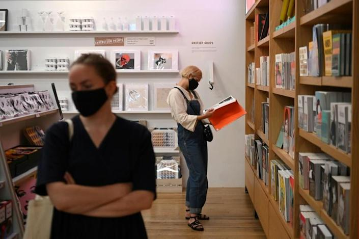 Britain made face masks mandatory in enclosed spaces (AFP Photo/DANIEL LEAL-OLIVAS)