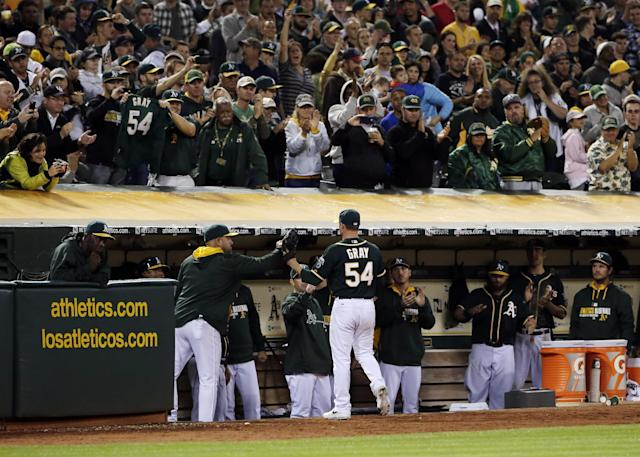 Oakland Athletics pitcher Sonny Gray gets a standing ovation as he leaves the baseball game during the ninth inning against the Los Angeles Angels on Friday, Aug. 22, 2014, in Oakland, Calif. Oakland won 5-3. (AP Photo/Marcio Jose Sanchez)