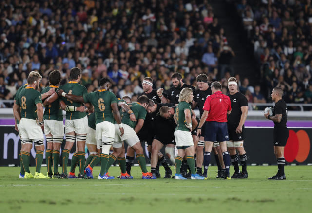 New Zealand and South African teams prepare for a scrum fight during the Rugby World Cup Pool B game between New Zealand and South Africa in Yokohama, Japan, Saturday, Sept. 21, 2019. (AP Photo/Shuji Kajiyama)