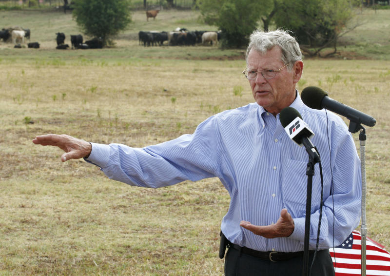 "FILE - In this Aug. 23, 2012, file photo, Sen. James Inhofe, R-Okla., speaks against the expansion of the Clean Water Act to authority over wet areas on private land in a pasture owned by Gary Johnson in Waukomis, Okla. While the looming fiscal cliff dominates political conversation in Washington, some Republicans and business groups see signs of a ""regulatory cliff"" they say could be just as damaging to the economy. President Barack Obama has spent the past year ""punting"" on a slew of job-killing regulations that will be unleashed in a second term, said Inhofe. (AP Photo/Sue Ogrocki, File)"