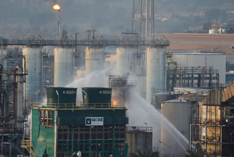 Firefighters spray water after a large fire broke out at the chemical factory, after explosion at a factory in the Tarragona