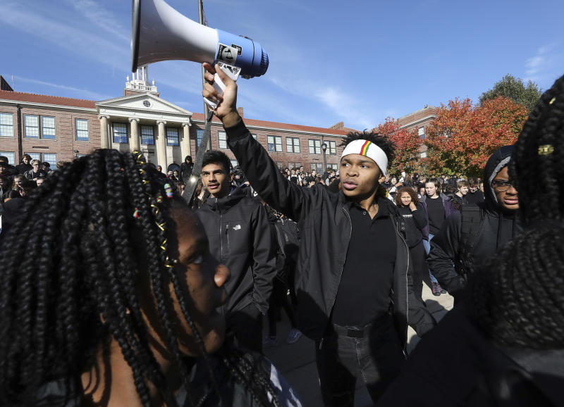 FILE - In this Friday, Oct. 18, 2019, file photo, Madison West High School senior Noah Anderson, 17, president of the school's Black Student Union and son of the school's recently-fired security guard Marlin Anderson, leads a rally in support of his father outside the school in Madison, Wis. Madison Metropolitan School District is rehiring Marlin Anderson, a security guard after he was fired last week for repeating a racial slur while telling a student not to use it, a union official said Monday, Oct. 21. (John Hart/Wisconsin State Journal via AP, File)