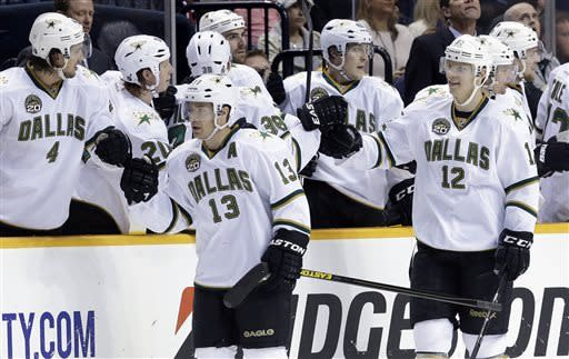 Dallas Stars forward Alex Chiasson (12) and left wing Ray Whitney (13) celebrate after Chiasson scored his first goal of the game against the Nashville Predators in the second period of an NHL hockey game on Friday, April 12, 2013, in Nashville, Tenn. (AP Photo/Mark Humphrey)