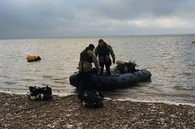 Royal Navy clearance divers prepare to detonate the bomb found near City airport (Royal Navy)